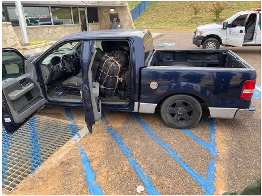 A suspected smuggler abandoned this vehicle with about 298 pounds of marijuana. U.S. Border Patrol agents said the suspect absconded into Mexico. Photo: Courtesy