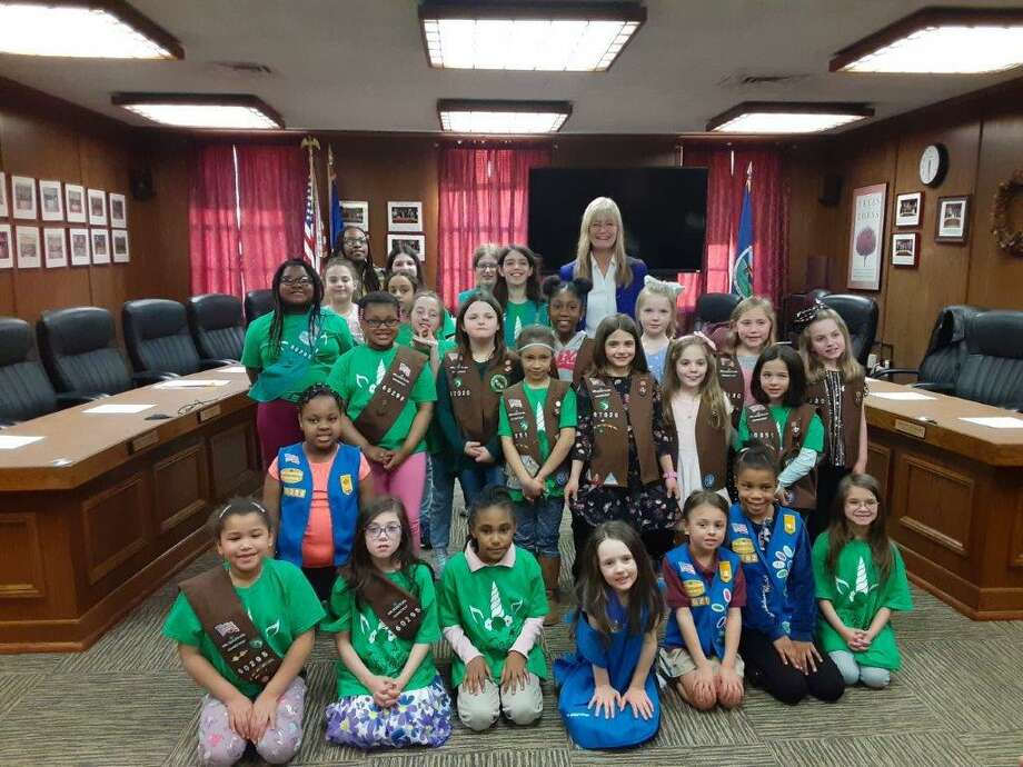 West Haven Mayor Nancy R. Rossi, back center, recognizes Girl Scouts of the West Haven Service Unit at City Hall on March 9. During the half-hour ceremony, Rossi, a former Girl Scout and troop leader, answered questions for 25 minutes before reading a mayoral proclamation declaring Girl Scout Day in West Haven. The event was coordinated by Troop 60298 leader Carrie Malangone, Troop 60321 leader Jennifer Ford, Troop 63020 leader Kerri Kennedy, Troop 60330 leader Heather Buccheri, Troop 60351 leader Kara Barton Nieves and Troop 60642 leader Kristy Brouillard. The observance marked the 108th anniversary of Girl Scouts of the United States of America, a national organization founded in 1912 by Juliette Gordon Low in Savannah, Ga. Photo: Contributed Photo