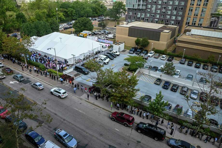 A line of people snakes down a full block and around the corner at Amazon Career Day in September.. Photo: Washington Post Photo By Jahi Chikwendiu / The Washington Post