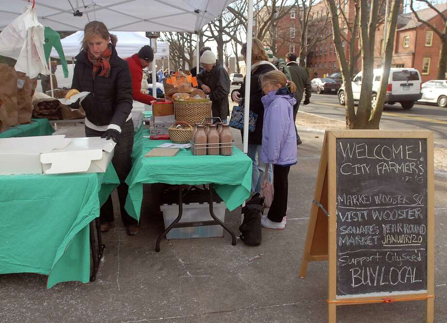 NEW HAVEN-FARMERS MARKET-PHOTO/JEFF HOLT-JH00183A 1/20/07-CitySeed co-founder and board member Anne Haynes dishes out pastries at the City Farmers Market in Wooster Square. The market will run the 3rd Saturday of every month through the winter and features, fresh dairy, meats, vegetables and bread etc. (Photo/Jeff Holt)