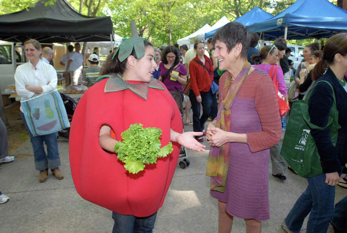 """Cas100501 05/01/10 New Haven-- Congresswoman Rosa DeLauro chats with Rachel Berg, Market Manager of the Wooster Square City Farmers' Market after Delauro threw out a ceremonial head of lettuce to celebrate the first day of the market.The City Farmer's Markets in New Haven are run by the non-profit """"CitySeed."""" Photos -Peter Casolino/New Haven Register *SEE ATTACHED INFO"""