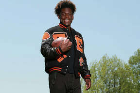 Edwardsville junior Justin Johnson is the 2019 Telegraph Large-Schools Football Player of the Year after racking up his second successive 1,000-yard season for an 8-3 Tigers squad.
