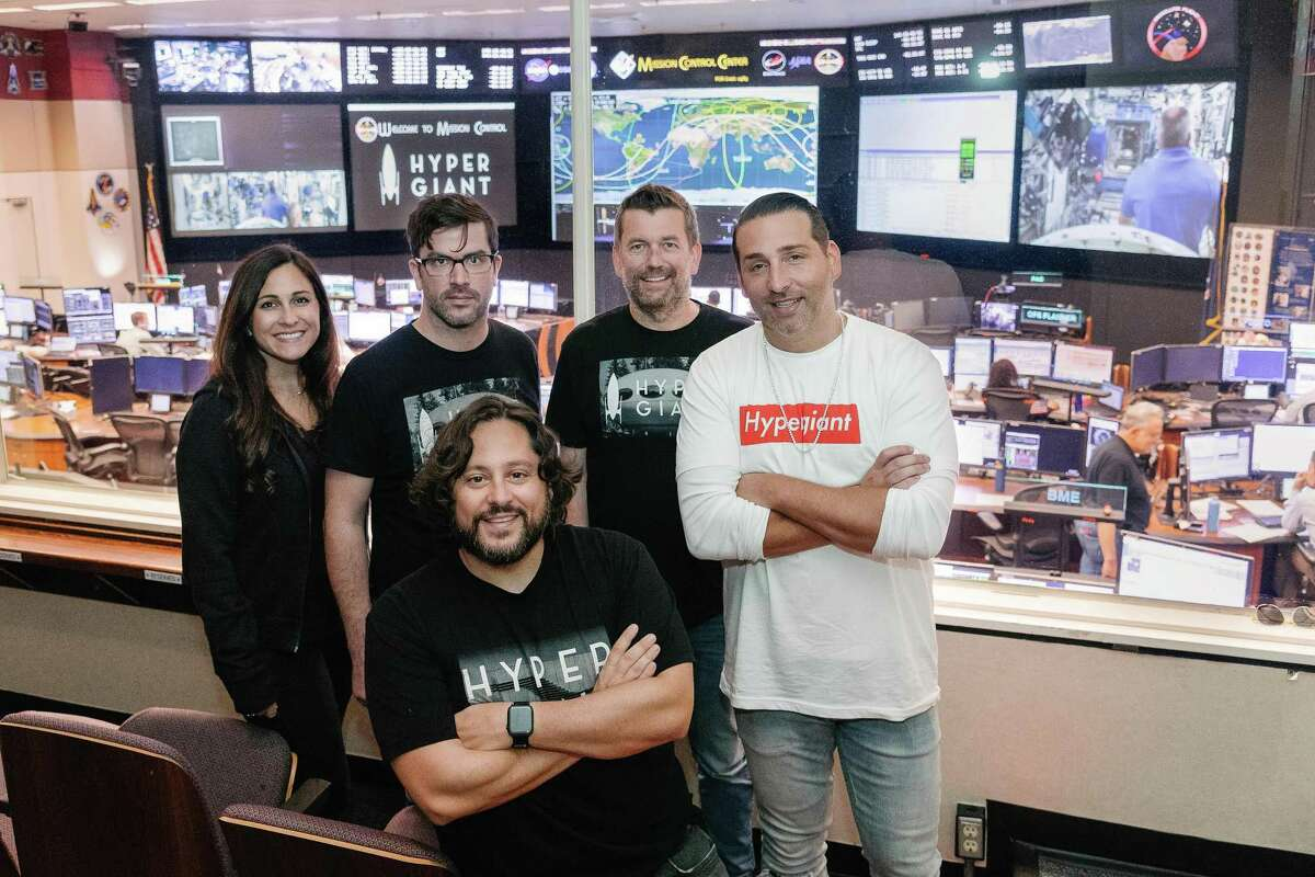 In front is Hypergiant Industries CEO Ben Lamm. Left to right behind him are Sarah Grant, Dan Haab, Greg Carley and Shawn Ullman.