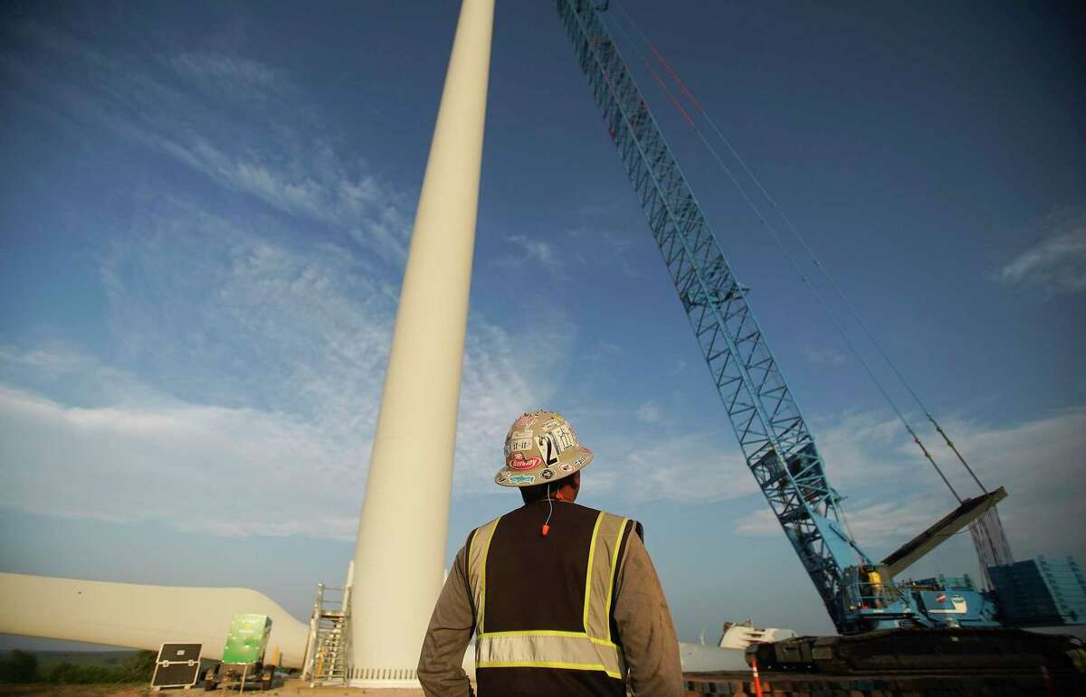 Santiago Huerta looks up at his worksite in North Texas on Thursday, May 21, 2020.