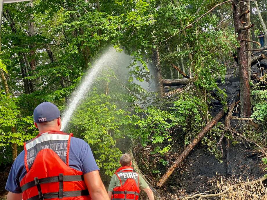 Firefighters put out a brush fire in Southbury, Conn., June 27, 2020. Photo: Brookfield Vol. Fire Dept. Candlewood Company Inc.