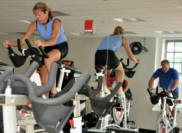 Darcy Ramsey, Fitness Director, leads a spinning class at