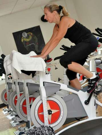 Kerry Grund, of Greenwich, participates in a spinning class