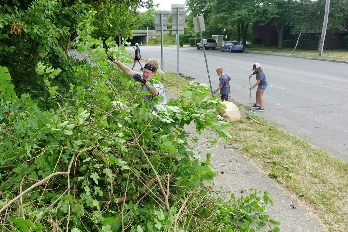 Volunteers, Carolann Cavanaugh, left, and her nephew and niece, Anthony and Bianca Scalise, clean up a small park on Tuesday, June 30, 2020, in Watervliet, N.Y. (Paul Buckowski/Times Union)