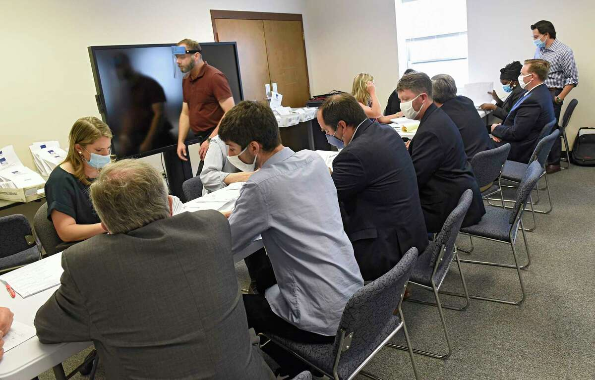 Ballot counting begins in the Albany County District Attorney's race between David Soares and Matthew Toporowski at the Albany County Board of Elections on Tuesday, June 30, 2020 in Albany, N.Y. Matthew Toporowski is seen overseeing the process at right. (Lori Van Buren/Times Union)