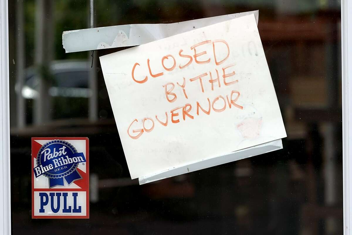 A sign on the door of the West Alabama Icehouse reads