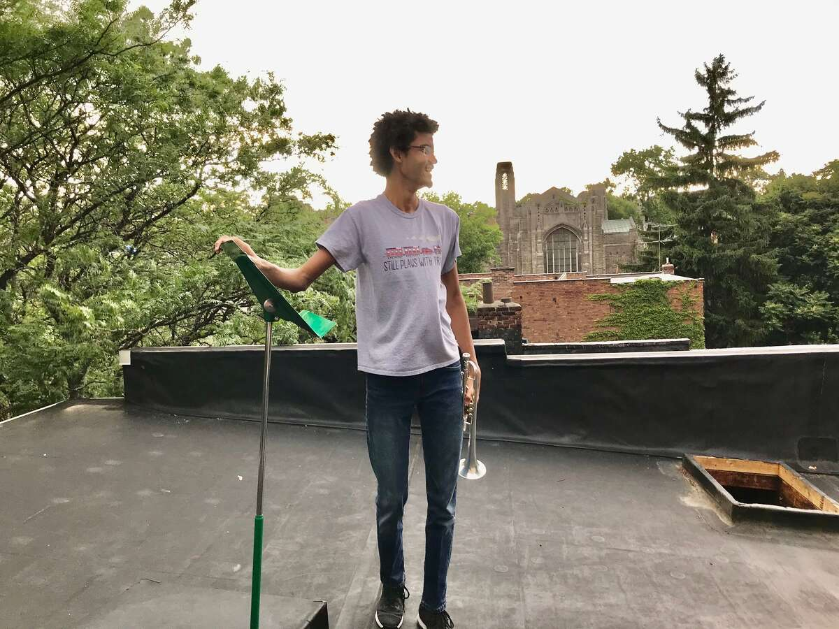 """Themba Pieterse just after he finished his four minute trumpet solo of Gloria Gaynor's """"I Will Survive"""" from the rooftop of his family's Lancaster Street townhouse on June 25"""