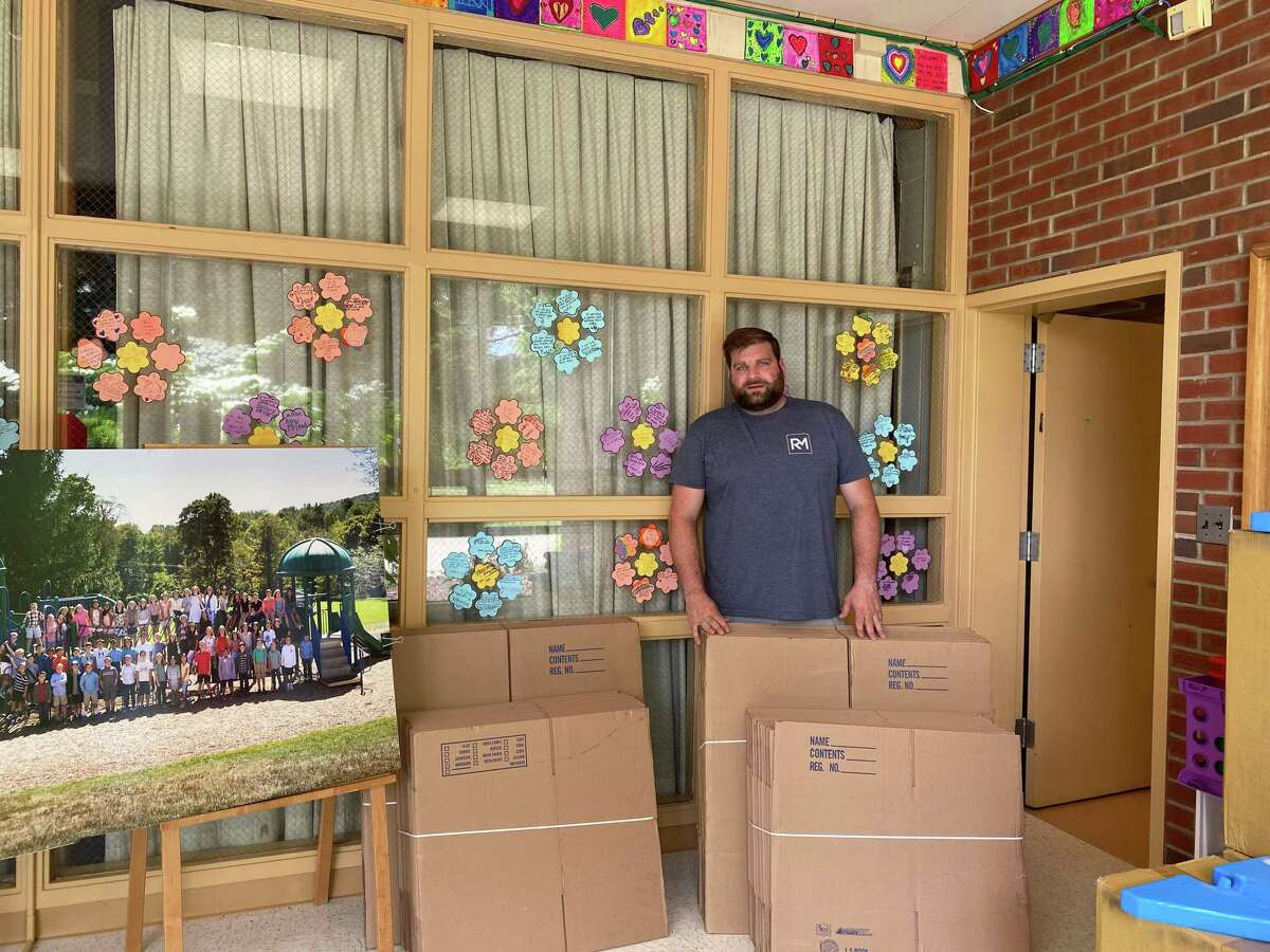 Ridgefield Moving founder Tom Tuohy during his visit at Scotland Elementary School.