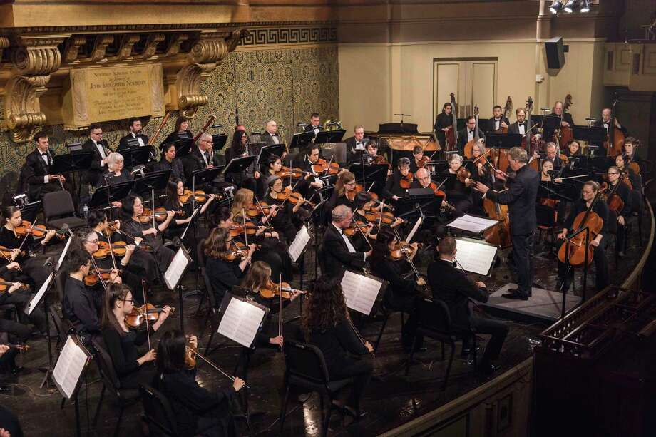 Alasdair Neale conducts the New Haven Symphony Orchestra in Woolsey Hall. Photo: NHSO / Contributed Photo