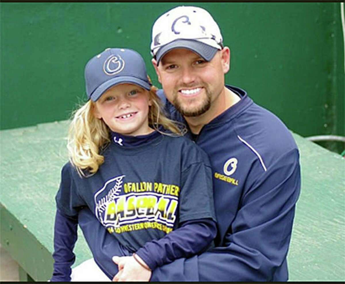Edwardsville graduate Nick Seibert poses for a photo with his daughter Addison when he was the pitching coach at O'Fallon High School.