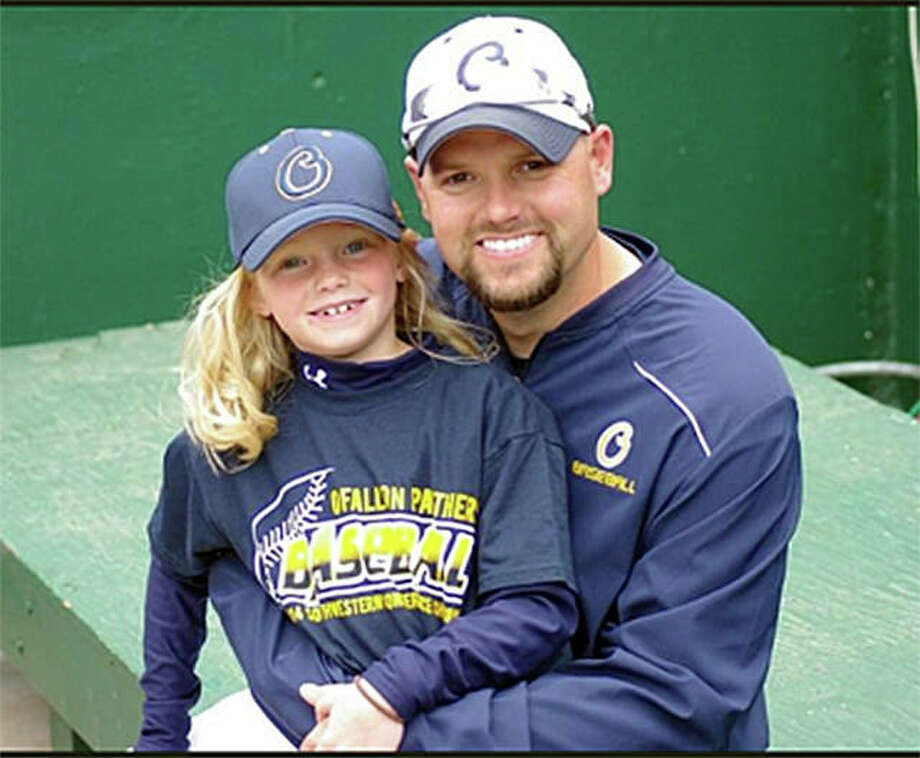 Edwardsville graduate Nick Seibert poses for a photo with his daughter Addison when he was the pitching coach at O'Fallon High School. Photo: For The Intelligencer