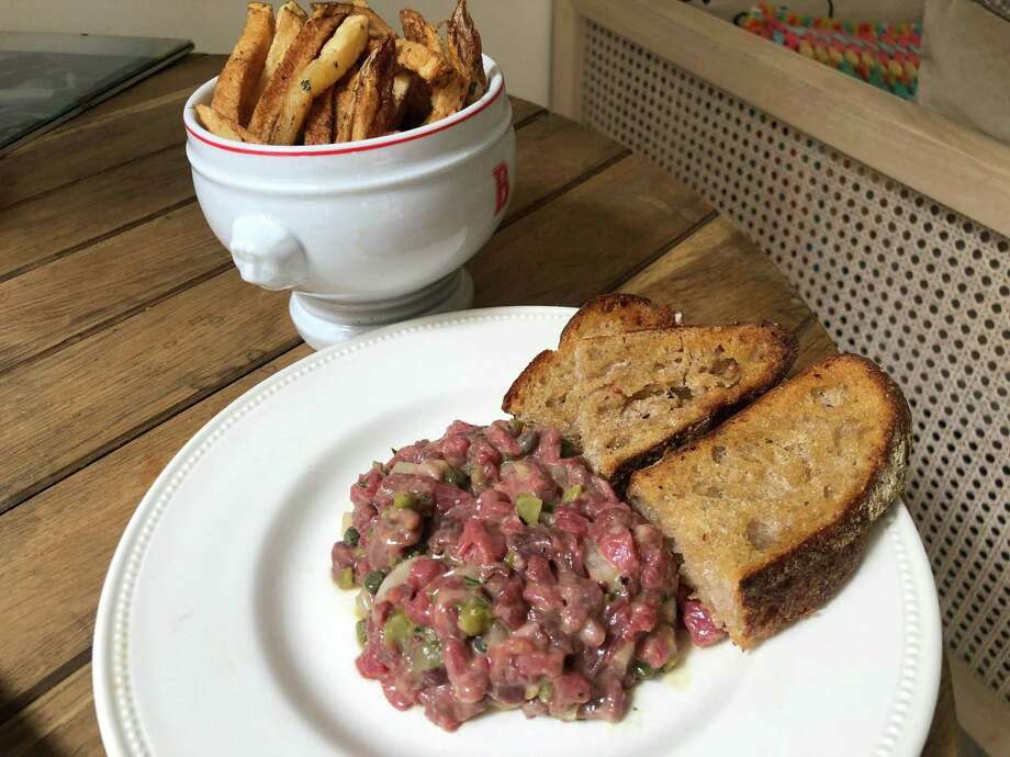 The writer's effort. Not a perfect tartare round, but delicious nonetheless. Photo: Bloomberg Photo By Kate Krader / Bloomberg