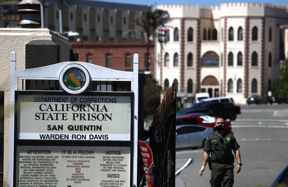 A California Department of Corrections and Rehabilitation (CDCR) officer wears a protective mask as he stands guard at the front gate of San Quentin State Prison on June 29, 2020 in San Quentin, California. S Photo: Justin Sullivan/Getty Images / 2020 Getty Images