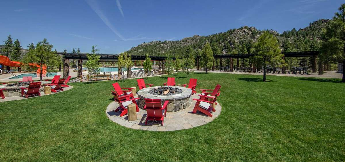 Multiple gas fire pits rest beside the pool and recreation area at the Summit Camp of Carson City's exclusive Clear Creek Tahoe community.