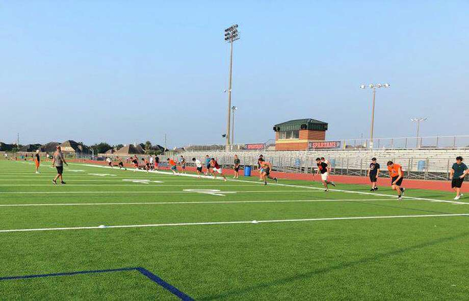 Seven Lakes student-athletes train during a summer strength and conditioning workout at Seven Lakes High School. Photo: Katy ISD