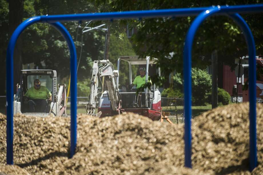 Construction work continues at Grove Park Tuesday, June 30, 2020 in Midland. The project includes added walkways, a new play area, a new basketball court, added trees and greenery and a new 60-space parking lot. (Katy Kildee/kkildee@mdn.net) Photo: (Katy Kildee/kkildee@mdn.net)