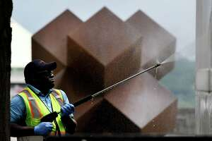 "Empire State Plaza gets a thorough cleaning as a crew from the state Office of General Services power washes a marble wall near Antoni Milkowski's steel sculpture, titled ""Salem 7, 1/3,"" on Tuesday, June 30, 2020, in Albany, N.Y. The angular artwork is located beneath The Egg. (Will Waldron/Times Union)"
