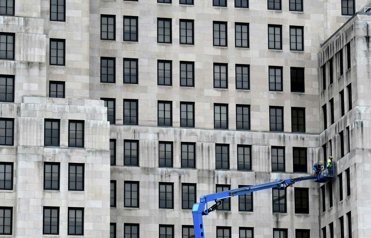 Repair work to the Alfred E. Smith Building windows takes place on Tuesday, June 30, 2020, in Albany, N.Y. (Will Waldron/Times Union)