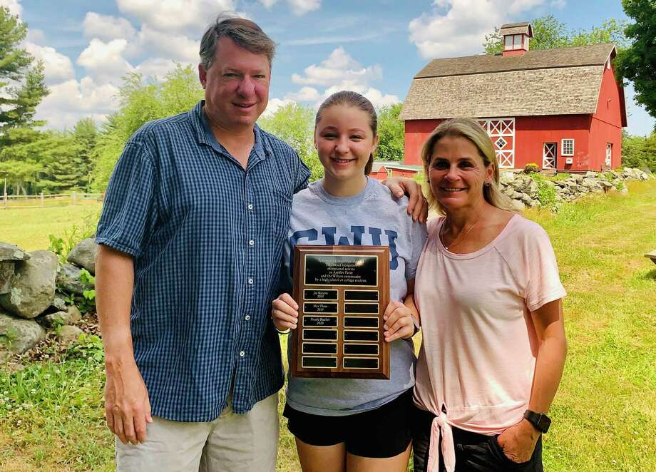 Nicole Beecher, shown with her parents James and Sharon Beecher, holds the plaque recognizing her as the recipient of Ambler Farm's 2020 Raymond-Ambler Award. Photo: Contributed Photo / Wilton Bulletin Contributed