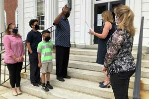 Stratford Town Clerk Susan Pawluk swears in Lorenzo Elder as a member of the Stratford Board of Zoning Appeals June 30, 2020 as Elder's wife, Jessica, sons Carter and Chance, and Mayor Laura Hoydick look on.