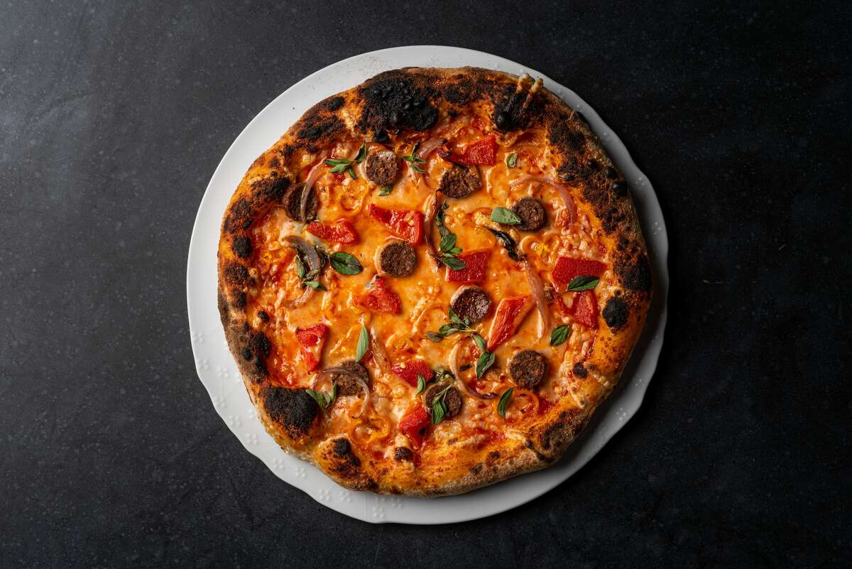 Chef Matthew Kenny, in collaboration with Kyle and Tracy Vogt, will debut BAIA in San Francisco by August 2020. The restaurant will begin as A Taste of BAIA, which will be available for takeout or delivery, as it waits for a full opening. Pictured is the sausage and pepper pizza.