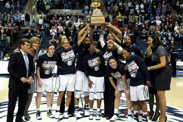 Coach Geno Auriemma and the UConn Huskies celebrate winning the 2011 Big East regular season championship.
