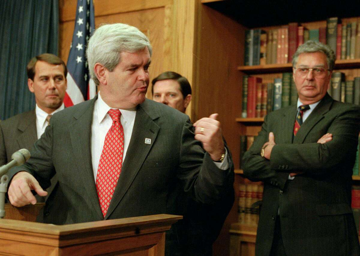 In taking over the House of Representatives in 1995, the new speaker, Newt Gingrich, gestures toward the GOP leadership team: House Majority Leader Dick Armey of Texas, right; Rep. John Boehner of Ohio, left; and Majority Whip Tom DeLay of Texas.