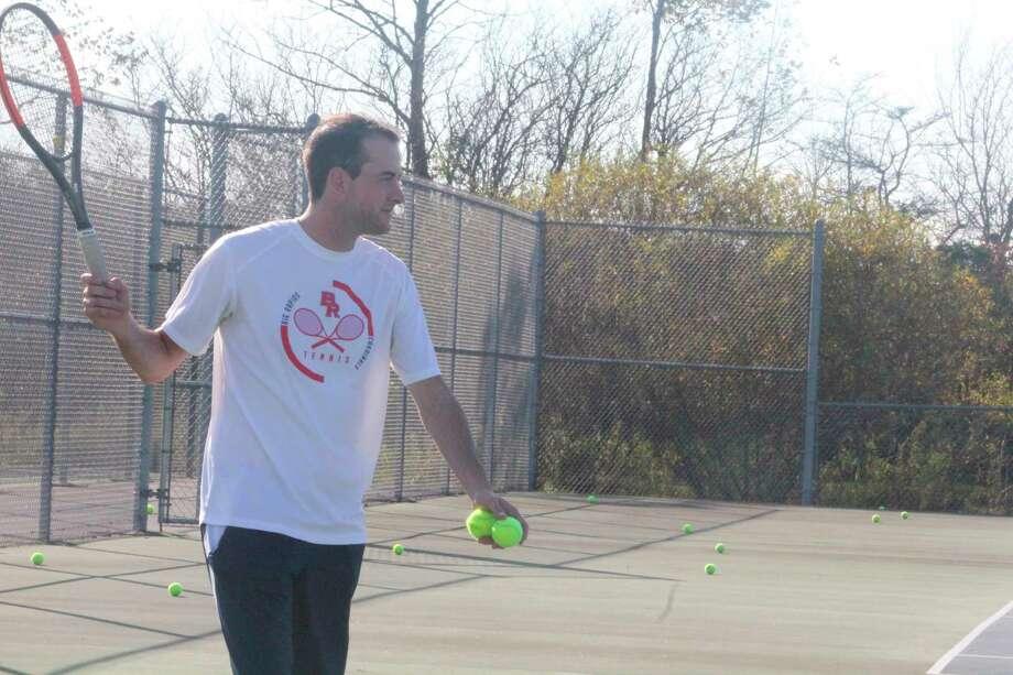 Big Rapids tennis player Austin Brinker works with athletes during a senior season last year. (Pioneer file photo)
