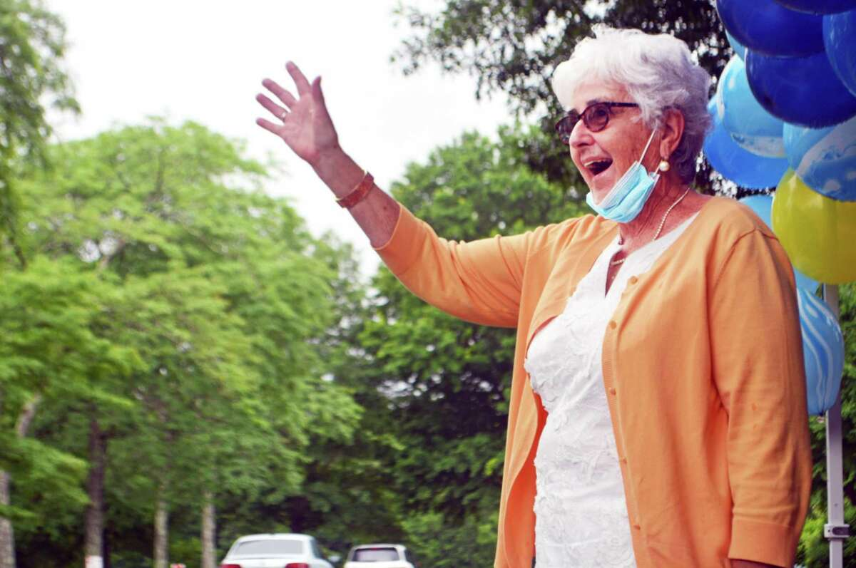 Sister Mary McCarthy, retiring president of Mercy High School in Middletown, was sent off in style Tuesday with a parade of police cruisers, fire trucks, family, friends, alumni and others offering her well wishes on her retirement.