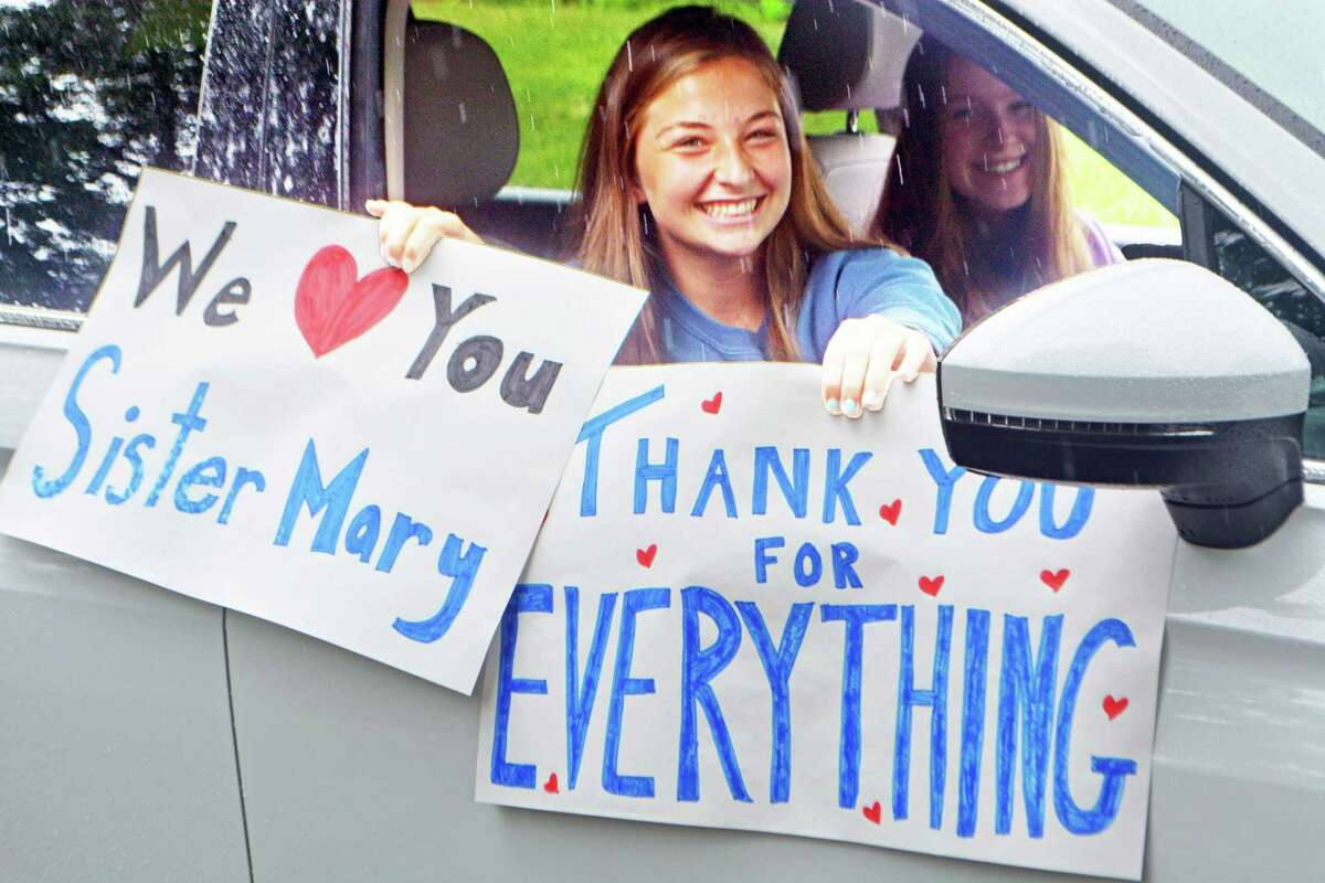 Mercy students joined a caravan of police and fire personnel who took part in a drive-by parade for retiring president Sister Mary McCarthy Tuesday.