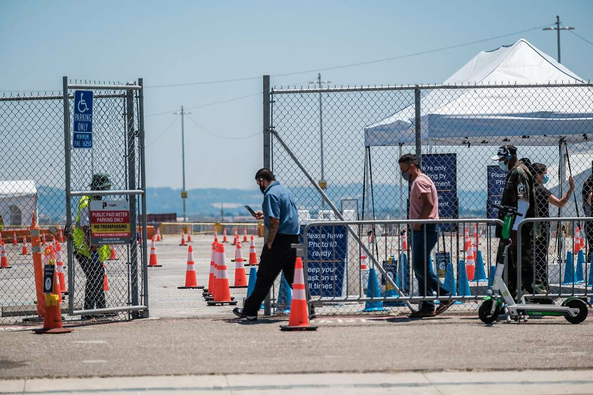 People are seen entering the Coronavirus testing site at Pier 30 in San Francisco, June 25, 2020.