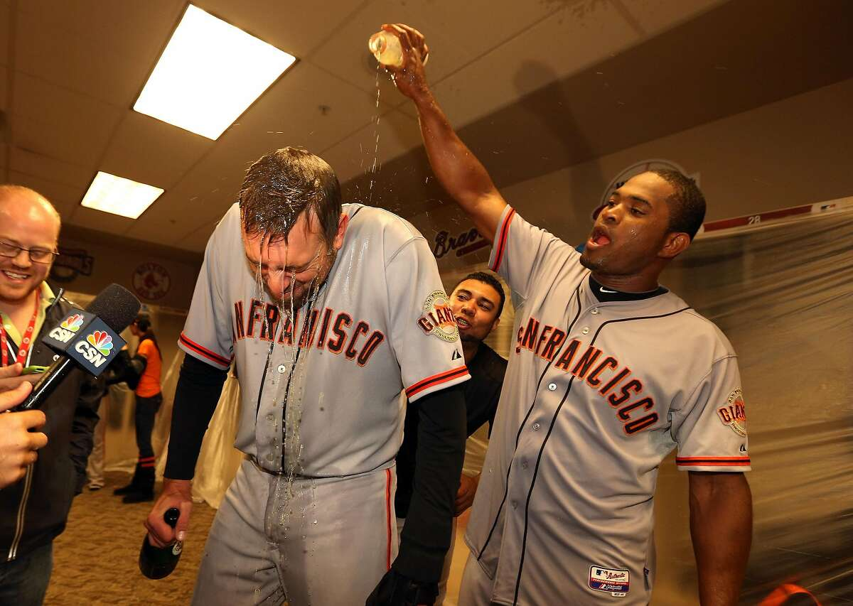 CINCINNATI, OH - OCTOBER 11: Santiago Casilla #46 pours gatorade on Jeremy Affeldt #41 of the San Francisco Giants as they celebrate in the locker room following Game Five of the National League Division Series against the Cincinnati Reds at Great Americ