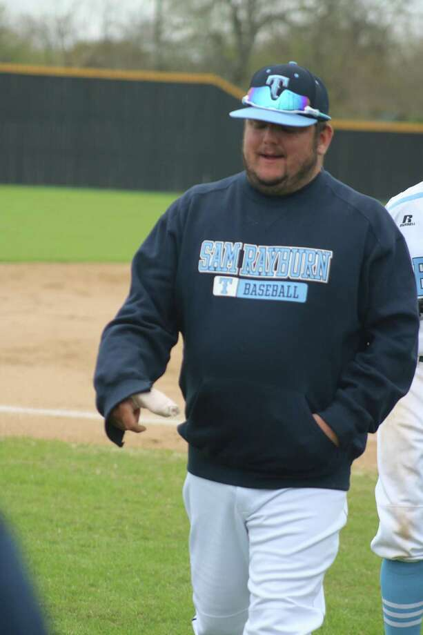 New Sam Rayburn head baseball coach Jaime Acosta leaves the third-base box during a game in March with his heavily-bandaged right hand and thumb. Acosta is now well on his way to a complete recovery. Photo: Robert Avery