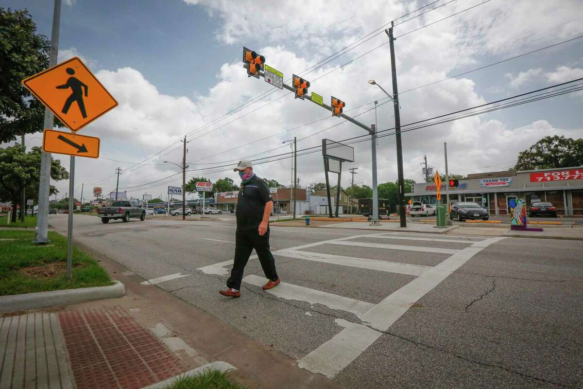 A man uses a new crosswalk to cross Shepherd at 10th Street on June 30, 2020, in Houston.