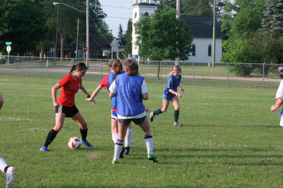 Big Rapids soccer girls partake in a informal workout on Monday at Industrial Field. (Pioneer photo/John Raffel)