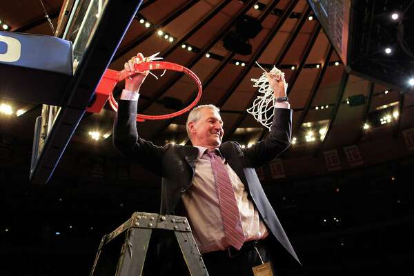UConn coach Jim Calhoun cuts down the nets after beating Louisville to win the 2011 Big East championship at Madison Square Garden.