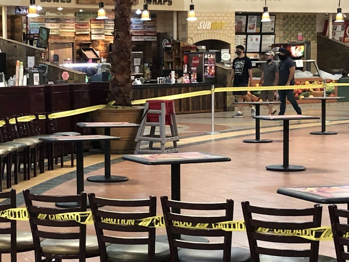 Shoppers at the Imperial Valley Mall walk around the closed food court on June 29, 2020. The mall reopened for several weeks, but county health officials decided to close it after facing pressure from Gov. Gavin Newsom due to a surge in coronavirus cases.