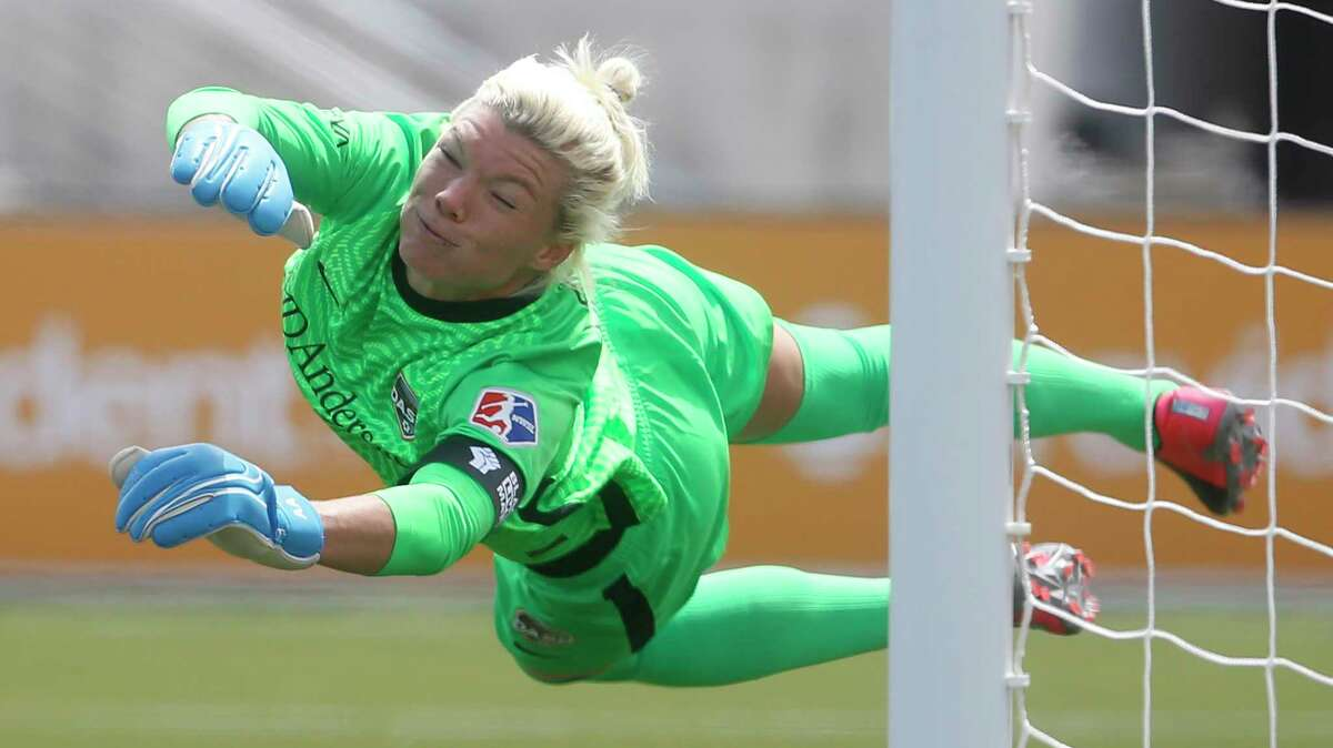 Houston Dash goalkeeper Jane Campbell is scored against by the Utah Royals FC free kick during the second half of an NWSL Challenge Cup soccer match.