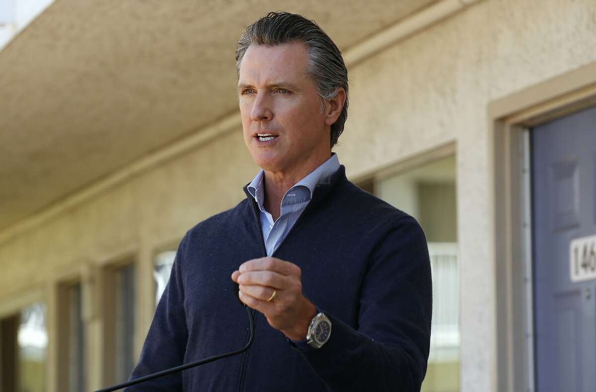 Gov. Gavin Newsom gives an update on the state's initiative to provide housing for homeless Californians to help stem the coronavirus, during a visit to a Motel 6 participating in the program in Pittsburg, Calif., Tuesday, June 30, 2020. Newsom announced that more than 15,000 rooms have been acquired and more than 14,000 people have been given places to stay statewide under the Project Room key program started in April. The governor also said he plans to announce on Wednesday plans to