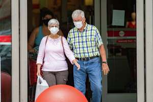 Shoppers leave the Target store still wearing their masks. Photo made on June 24, 2020. Fran Ruchalski/The Enterprise