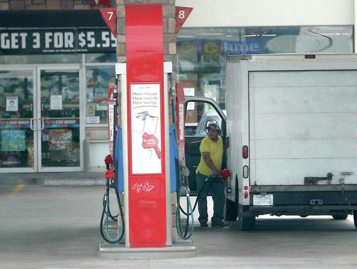 A man pumps gas at a gas station in the Heights on June 30, 2020, in Houston.