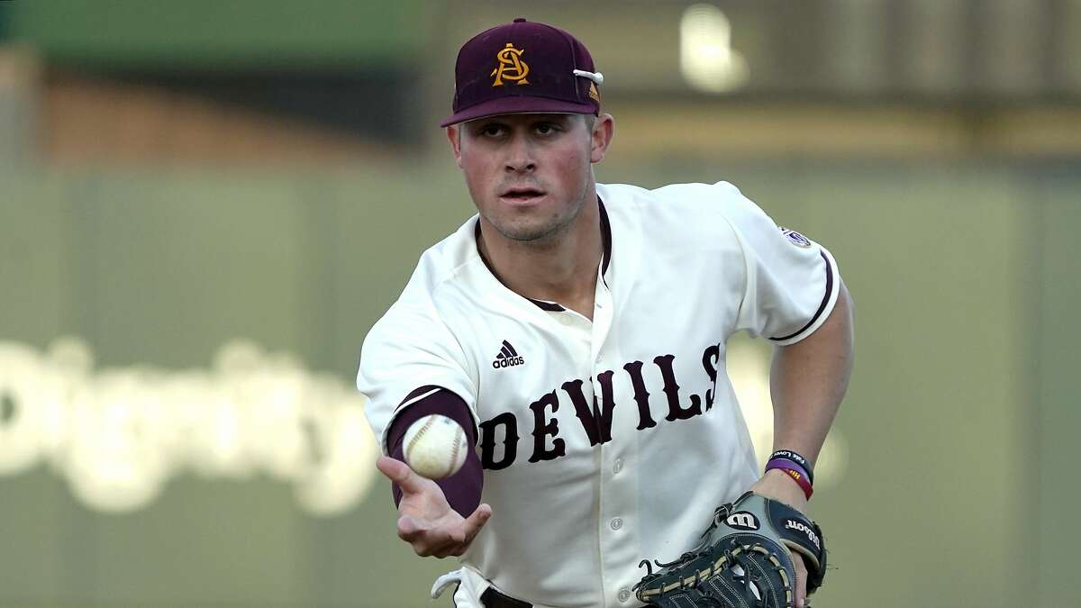 In this Feb. 18, 2020 photo Arizona State infielder Spencer Torkelson makes a play during an NCAA college baseball game in Phoenix, Ariz. The Detroit Tigers agreed to terms Tuesday, June 30, 2020 with No. 1 overall draft pick Spencer Torkelson, and the team said he's joining the player pool for this abbreviated season. (AP Photo/Rick Scuteri)