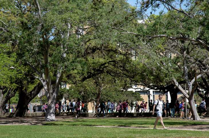 Students walk through campus between classes at Texas A&M University, Thursday, March 23, 2017, in College Station. ( Jon Shapley / Houston Chronicle )