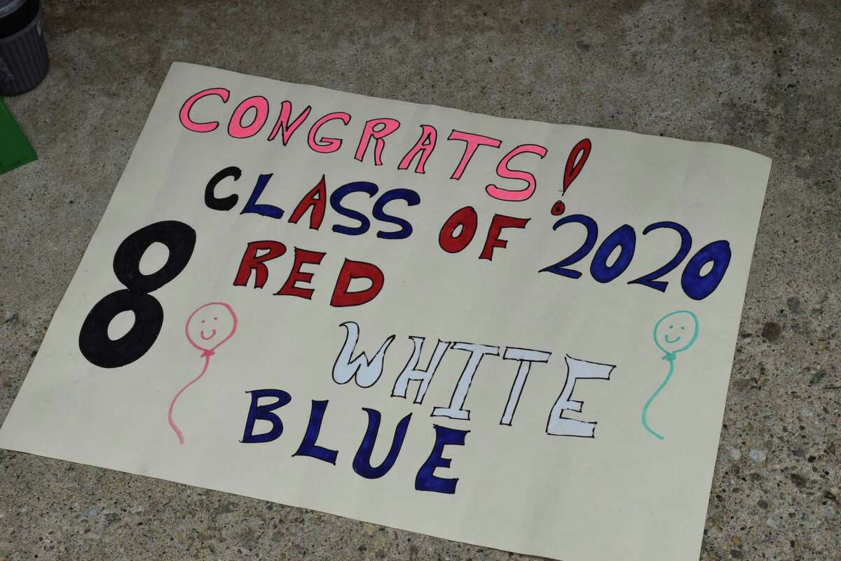 Spectrum/Schaghticoke Middle School in New Milford held three separate drive-through promotion ceremonies for its eighth-grade students June 15, 2020. A variety of signs, like the one above, were held up by school staff and administrators as families drove through the parking lot.