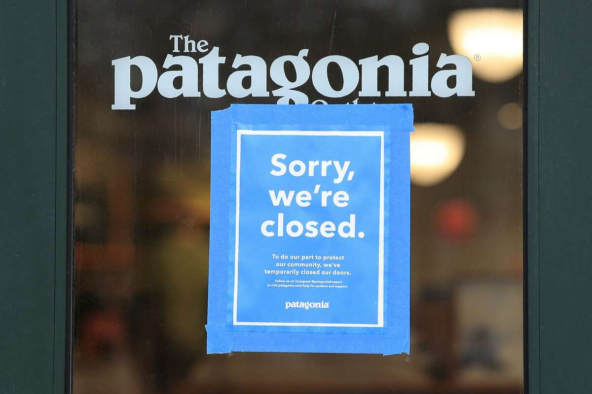 """FILE - This April 9, 2020 file photo shows a closed Patagonia clothing store in Freeport, Maine. The outdoor gear company Patagonia is the latest brand to announce an advertising boycott of Facebook and its Instagram app, saying the social media giant has """"failed to take steps to stop the spread of hateful lies and dangerous propaganda on its platform."""" Patagonia joins The North Face and the outdoor gear company REI, which have announced similar boycotts in recent days. It is not clear how much the boycotts will affect Facebook's advertising revenue, which was nearly $70 billion in 2019, making up nearly all of its total revenue. (AP Photo/Robert F. Bukaty)"""