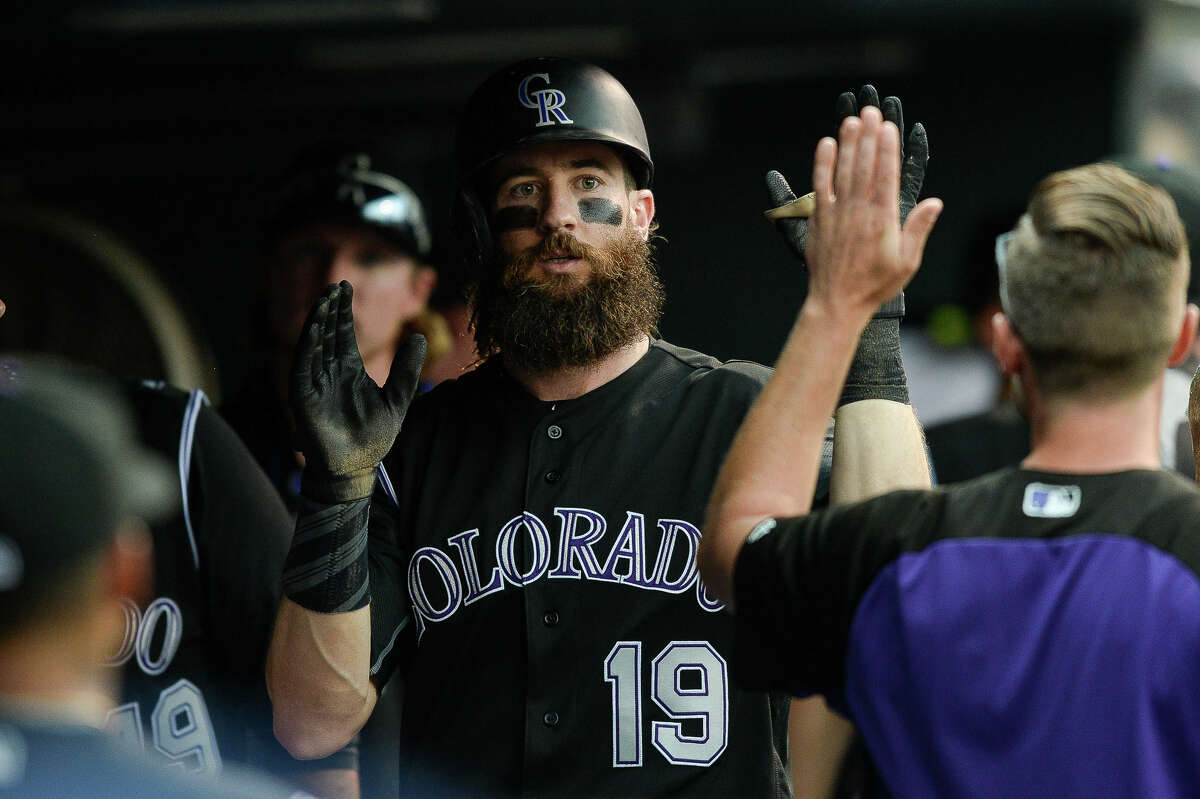 DENVER, CO - AUGUST 30: Charlie Blackmon #19 of the Colorado Rockies celebrates in the dugout after hitting a sixth inning solo homerun against the Detroit Tigers at Coors Field on August 30, 2017 in Denver, Colorado. (Photo by Dustin Bradford/Getty Images)